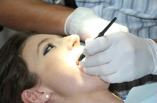 После удаления корня зуба опухла щека